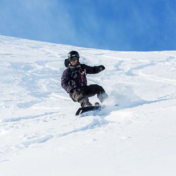 Snowboarding Instructor Jono Stevens Riding his board