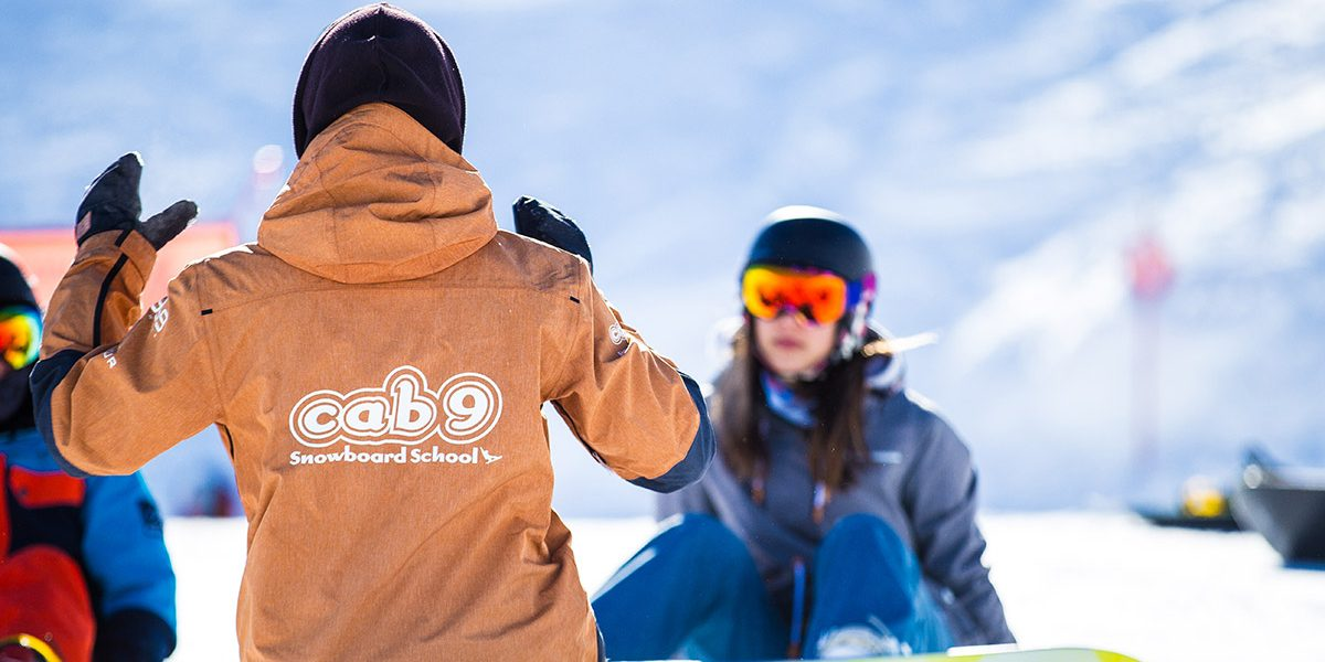 Snowboard tutor giving a lesson