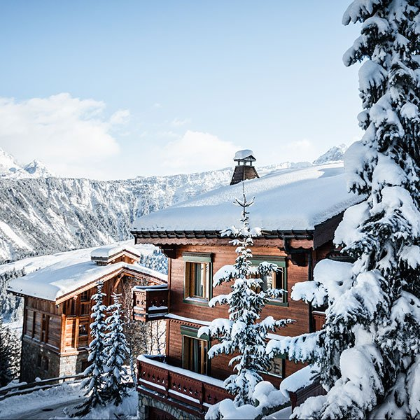 Courchevel snowboard resort looking at snow topped accommodation