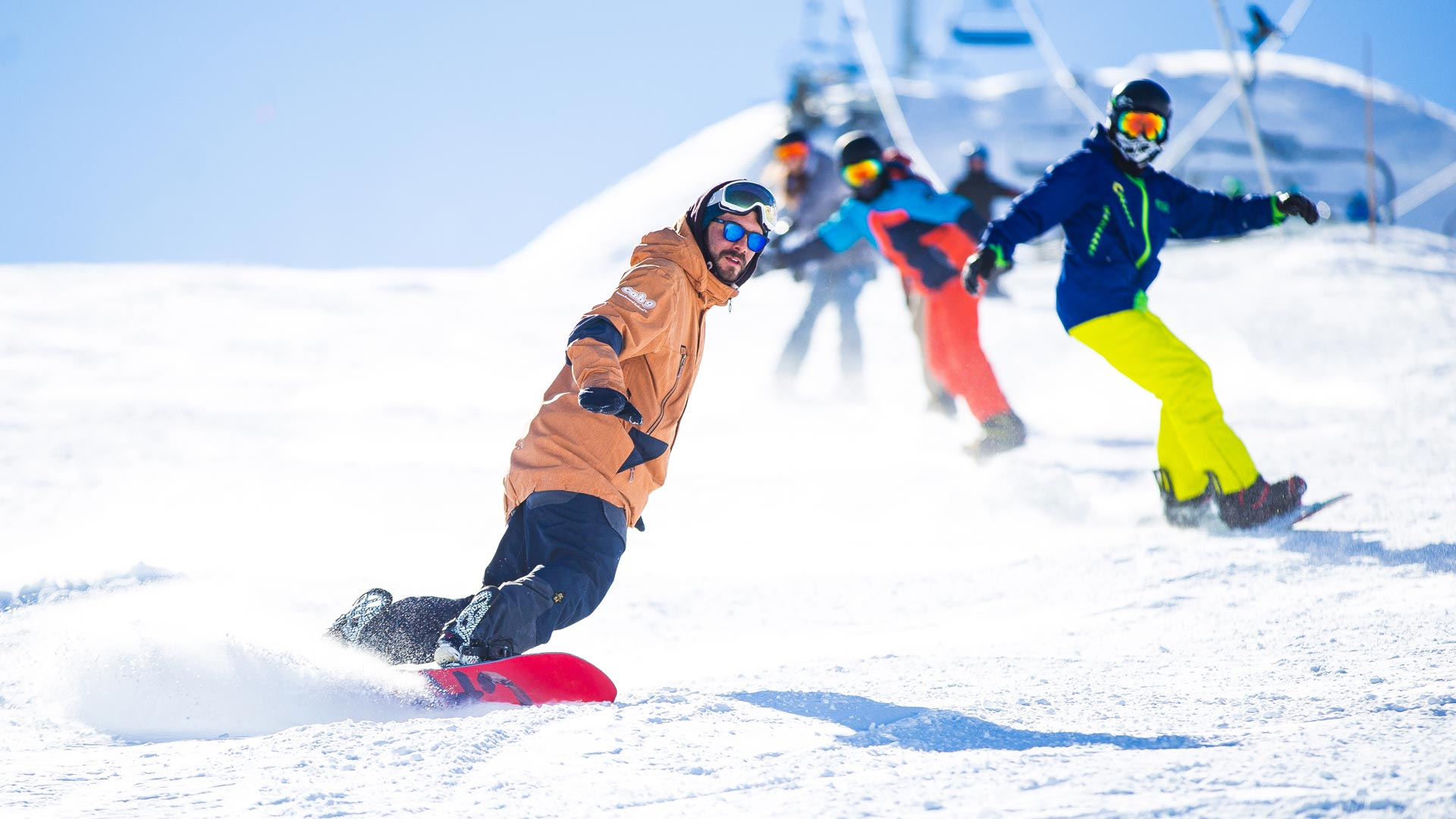 Snowboard teacher teaching group of snowboard studentson a Cab9 Snowboarding lessons in Courchevel